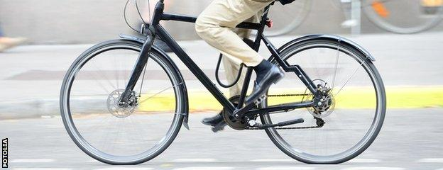 Cyclist in a suit