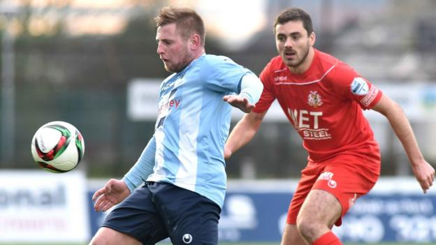 Ballymena's David Cushley shields the ball from Portadown defender Chris Ramsey