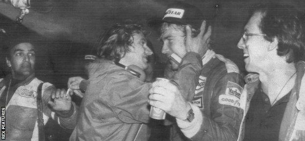 James Hunt celebrates in the McLaren garage
