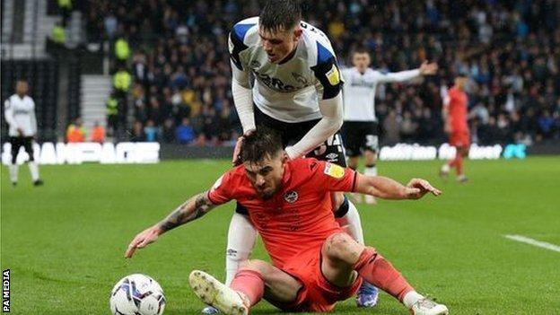 Swansea's Ryan Manning tangles with Jack Stretton, who made his first league start for Derby