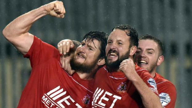 Portadown defender Ken Oman (left) celebrates with team-mates after he scores his second goal to clinch a 3-2 victory at Carrick