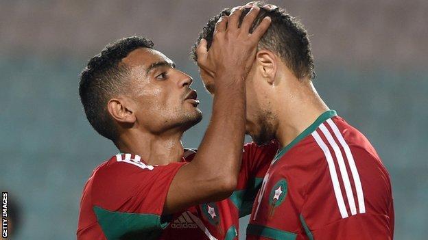 Morocco striker Abdessalam Ben Jelloun (right) is congratulated after scoring a goal against Libya