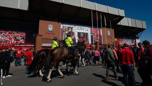 Police on horseback outside Anfield