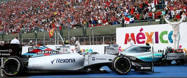 Nico Rosberg salutes the grandstands as the celebrations begin in Mexico