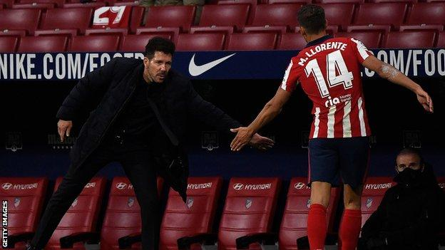 Diego Simeone and Marcos Llorente