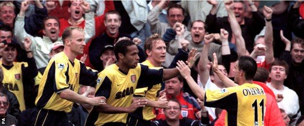 Thierry Henry celebrates his first goal for Arsenal