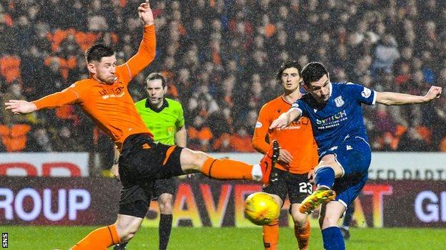 Graham Dorrans (right) scores Dundee's equaliser