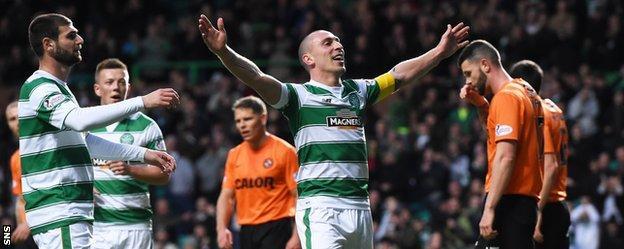 Celtic's Scott Brown celebrates scoring against Dundee United