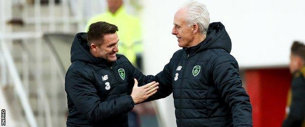Robbie Keane and Mick McCarthy celebrate Jeff Hendrick's goal