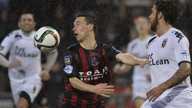 Crusaders winger Paul Heatley shields the ball from Glentoran's Fra McCaffrey
