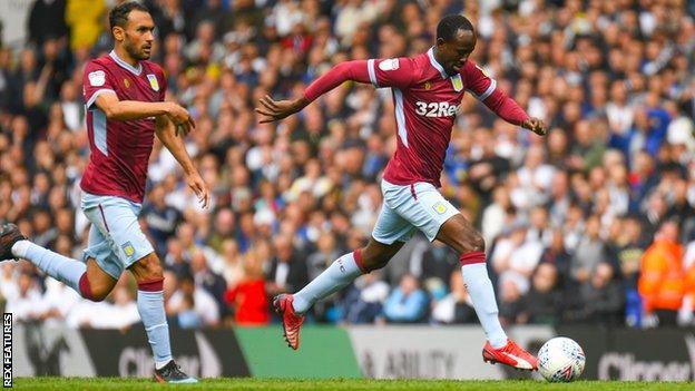 Albert Adomah walks in Aston Villa's equaliser against Leeds United