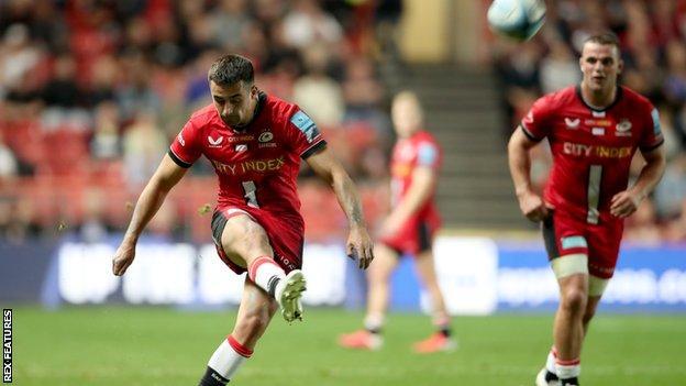 Alex Lozowski kicks at goal for Saracens