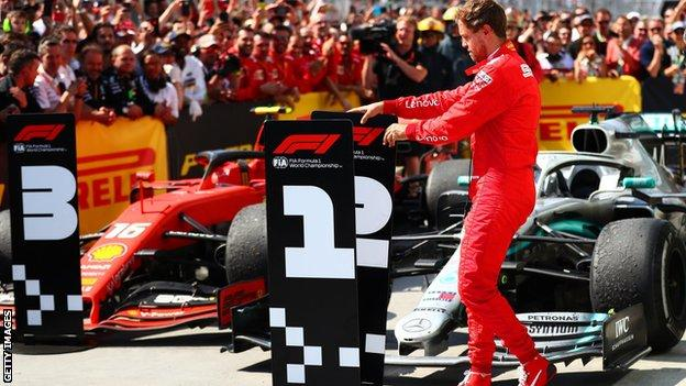 Sebastian Vettel moves the number boards at the Canadian GP