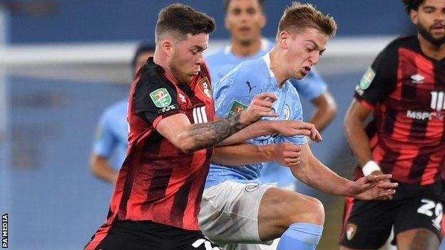 Bournemouth centre-half Jack Simpson (left) in action against Manchester City