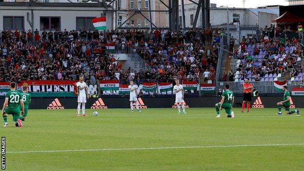 The Republic's players take a knee before Tuesday's game in Budapest
