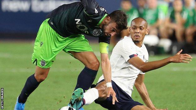 Bruno Fernandes (left) is tackled by Liverpool's Fabinho