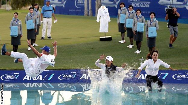 South Korea's Jin Young Ko (centre), her caddie and agent jump in Poppie's Pond in 2019