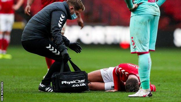 Andreas Weimann injured during Bristol City's match against Swansea City