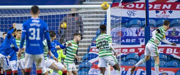 Callum McGregor (right) looks on as the ball goes into his own net off his shoulder