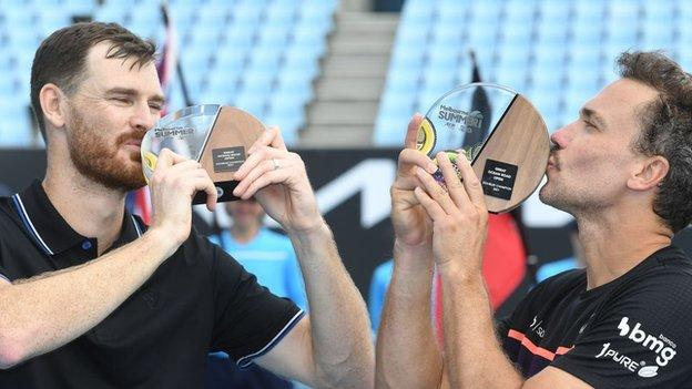 Jamie Murray and Bruno Soares kiss their trophies for winning last week's Great Ocean Road Open