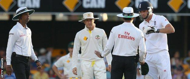 Australia captain Michael Clarke (second from left) was fined for his part in a clash with England bowler James Anderson (right)