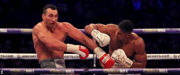 Anthony Joshua (right) lands a punch on Wladimir Klitschko