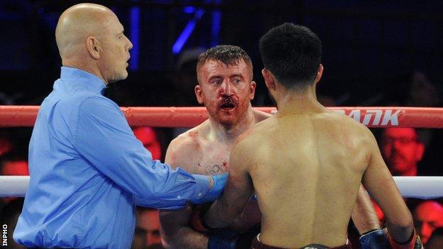 A bloodied Paddy Barnes during his defeat by Oscar Mojica in New York