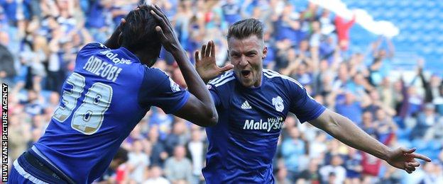 Sammy Ameobi celebrates Cardiff's forst goal with scorer Anthony Pilkington