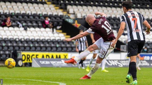 Hearts striker Liam Boyce scores