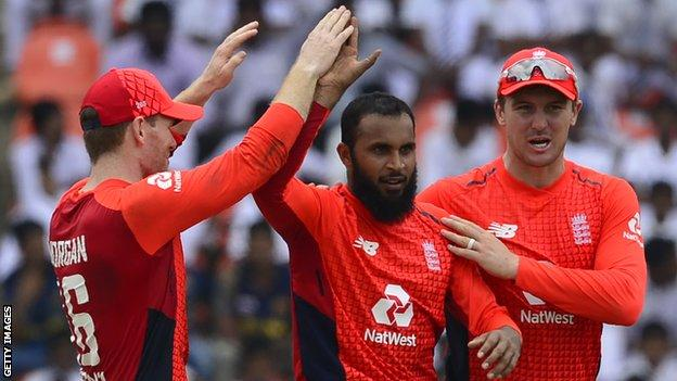 England captain Eoin Morgan congratulates bowler Adil Rashid on taking a wicket v Sri Lanka