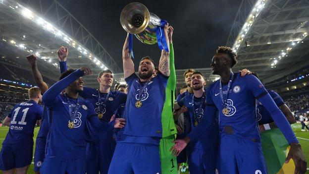 Olivier Giroud celebrates lifting the Champions League with Chelsea