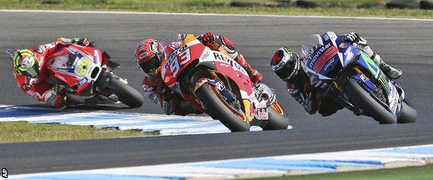 Marc Marquez of Spain (center) leads Jorge Lorenzo of Spain (right) and Andrea Iannone of Italy