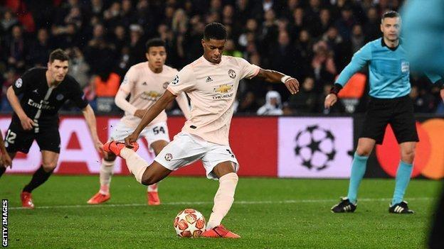 Marcus Rashford scores an injury-time penalty to knock PSG out of this season's Champions League