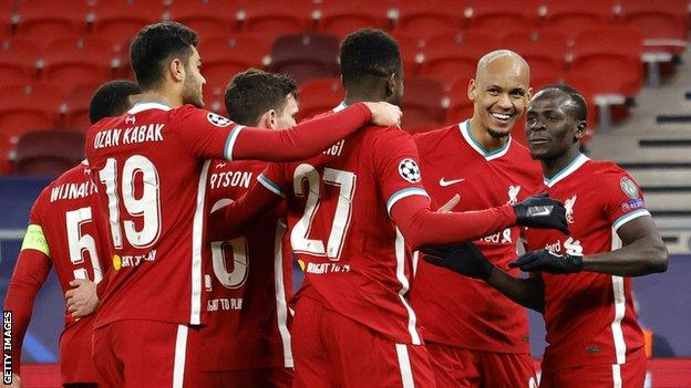 Fabinho (second from right) celebrates with Liverpool team-mates