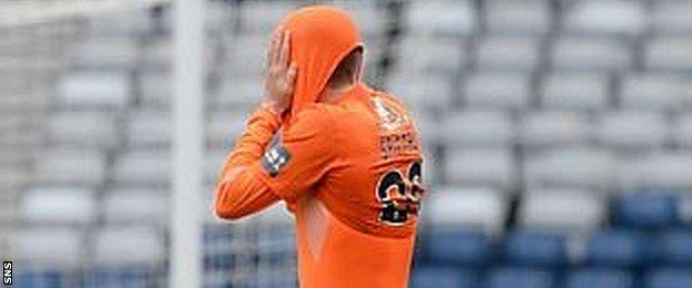 Blair Spittal puts his head inside his jersey after defeat in the penalty shoot-out