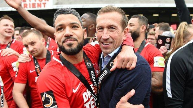 Justin Edinburgh (right) celebrates with Jobi McAnuff as Leyton Orient win promotion in April
