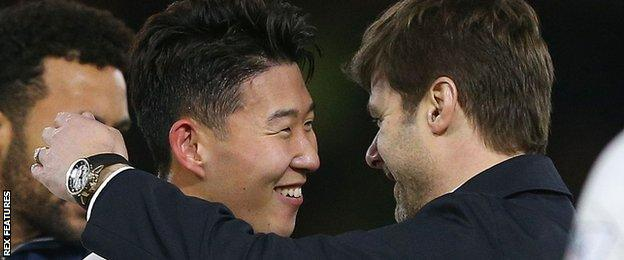 Son Heung-Min (left) is congratulated by manager Mauricio Pochettino after his winner for Spurs