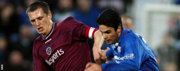 Mikel Arteta (right) in action for Rangers