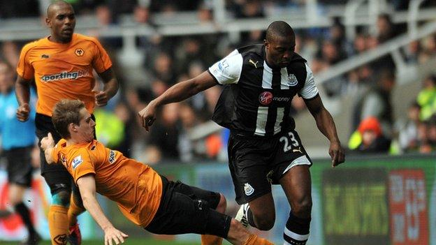 Shola Ameobi is tackled by Wolves' Dave Edwards, February 2012