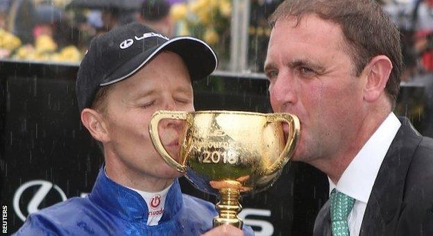 Winning jockey Kerrin McEvoy and trainer Charlie Appleby after Cross Counter's Melbourne Cup win