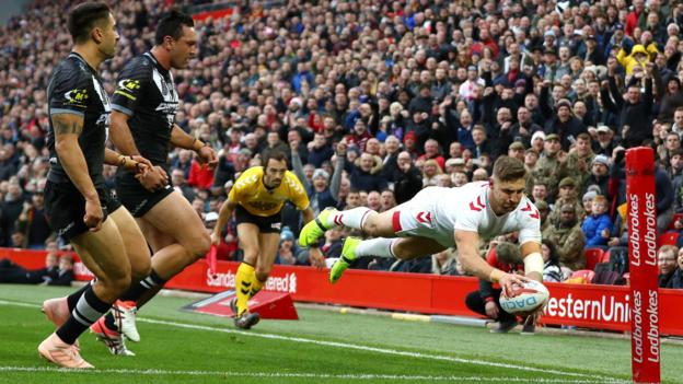 Tommy Makinson scores a try for England against New Zealand in the second of the three-match Test series