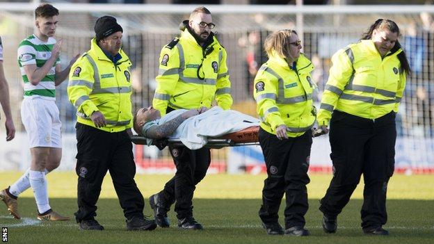 Jonny Hayes is carried off on a stretcher