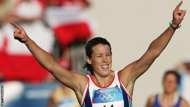 Great Britain's Georgie Harland celebrates winning modern penthatlon bronze at the 2004 Athens Olympics