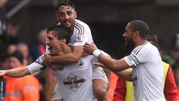 Jack Cork, Neil Taylor and Ashley Williams celebrate a Swansea goal