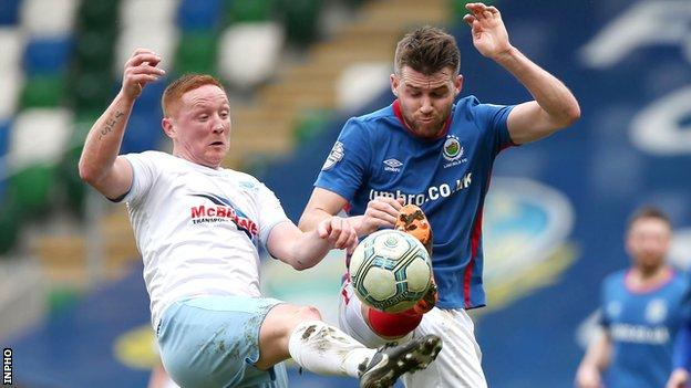 Stephen McAlorum battles with Linfield's Stephen Lowry in April