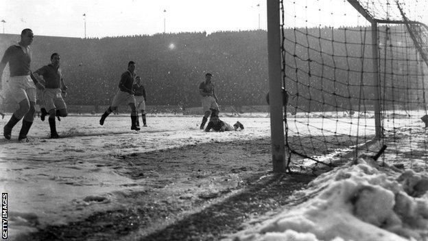 Blackpool score their first goal against Chelsea on a snow-covered pitch at Stamford Bridge in March 1947