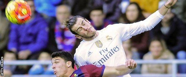 Gareth Bale wins an aerial challenge for Real Madred at Eibar