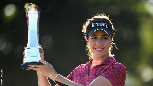 Georgia Hall holding the British Open trophy