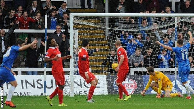 Jake Gray (left) celebrates his first goal against Leyton Orient
