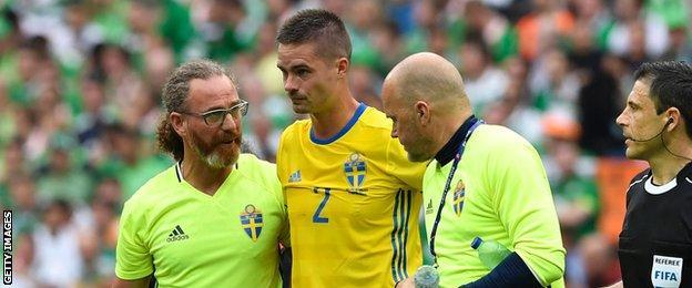 Sweden's medical team escort Mikael Lustig off the field in France